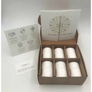 open gift box with six ritual candles with the detail of the symbols