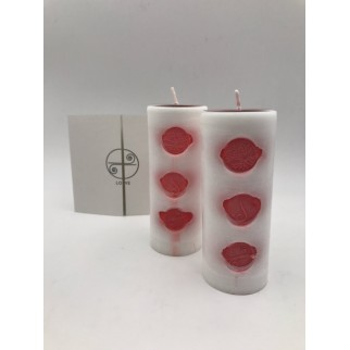 two love candles with the red symbols and the brochure