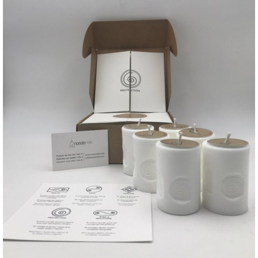 pack of six candles prepared with the protection symbol in a gift box