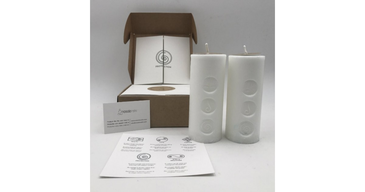 pack of two candles for protection with the symbol engraved and in a gift box
