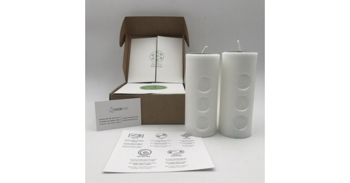 pack of two candles for peace and  harmony with the symbol engraved and in a gift box