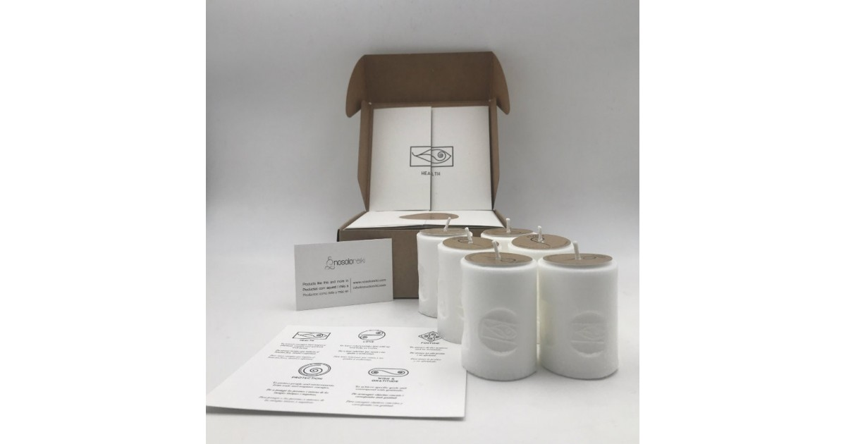 pack of six candles of health with the symbol engraved and in a gift box