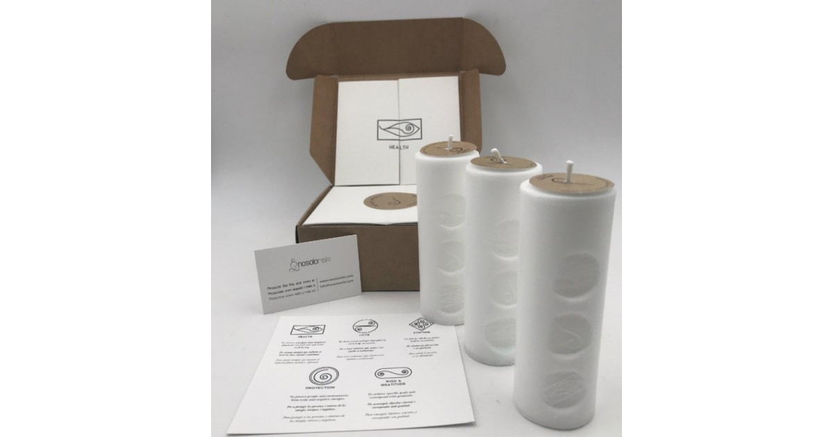 pack of three candles of health with the symbol engraved and in a gift box