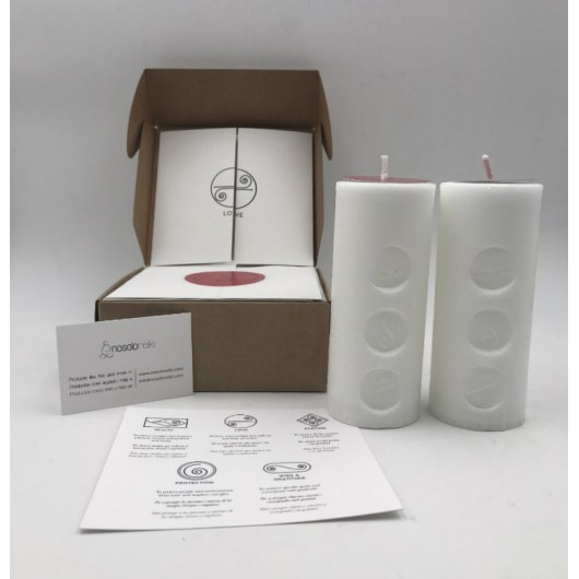 pack of two candles for love with the symbol engraved in a gift box
