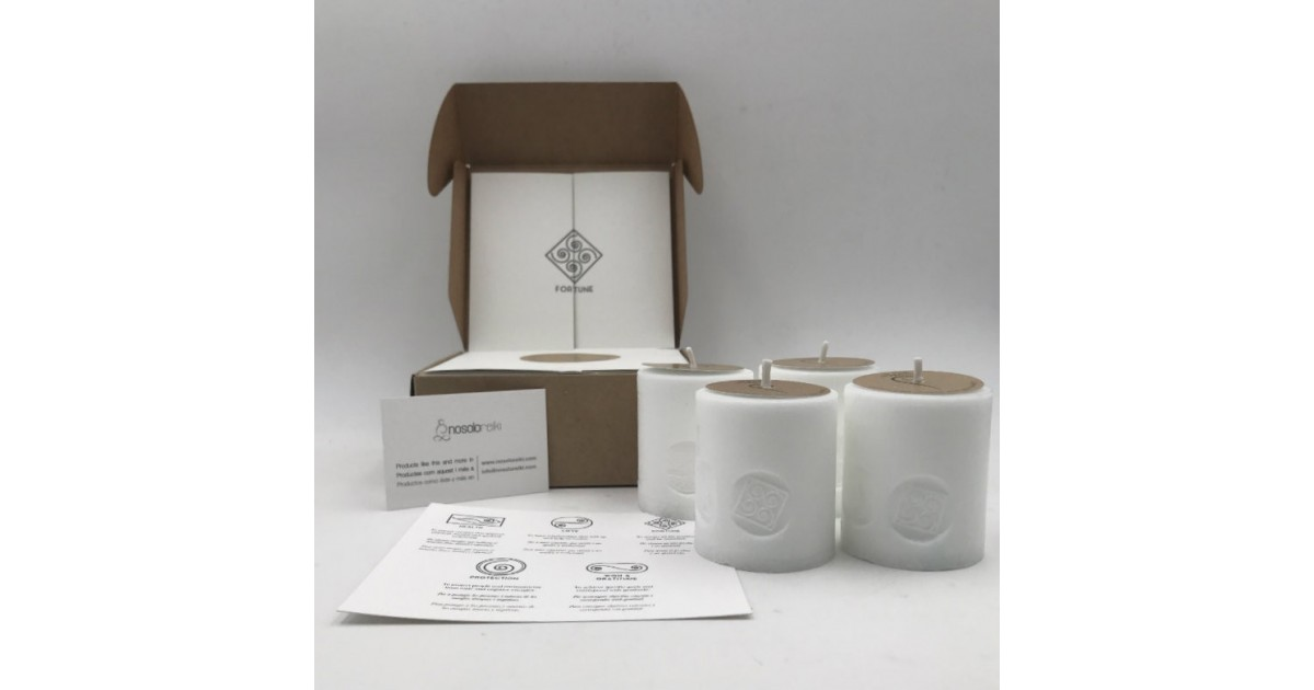 pack of four candles for fortune with the symbol engraved and in a gift box