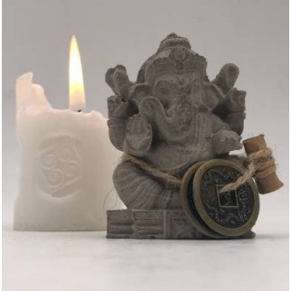 Fortune candle lighted with the Ganesh figure and the I-Ching coins and the petition of the ritual